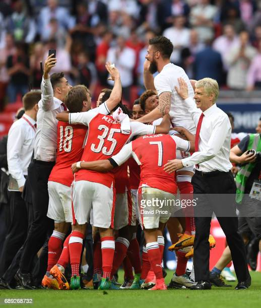 Arsene Wenger the Manager looks on as his players celebrates after the match between Arsenal and Chelsea at Wembley Stadium on May 27 2017 in London...