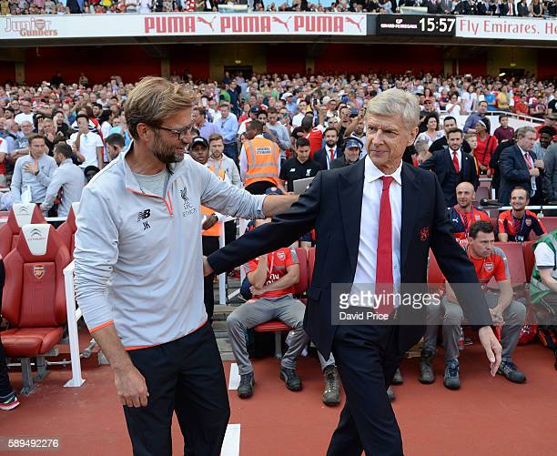 Arsene Wenger the Manager of Arsenal and Jurgen Klopp the Liverpool Manager greet each before the Premier League match between Arsenal and Liverpool...