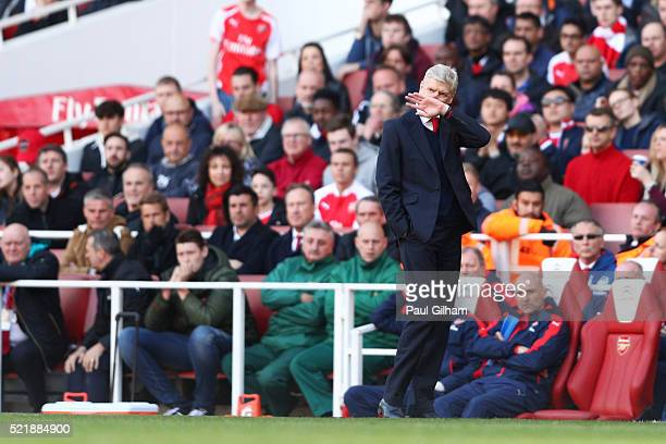 Arsene Wenger the manager of Arsenal looks dejected after seeing his side concede during the Barclays Premier League match between Arsenal and...