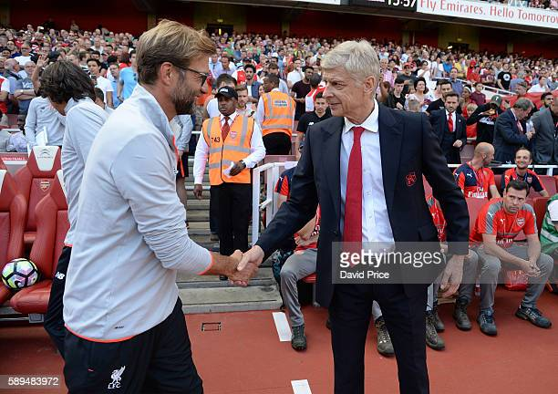 Arsene Wenger the Manager of Arsenal shakes hands with Jurgen Klopp the Liverpool Manager before the Premier League match between Arsenal and...