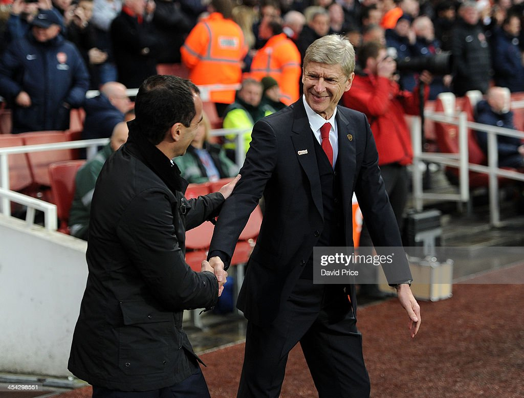 <a gi-track='captionPersonalityLinkClicked' href=/galleries/search?phrase=Arsene+Wenger&family=editorial&specificpeople=171184 ng-click='$event.stopPropagation()'>Arsene Wenger</a> the Manager of Arsenal shakes hands with Roberto Martinez the Manager of Everton before the Arsenal against Everton Premier League match at Emirates Stadium on December 8, 2013 in London, England.