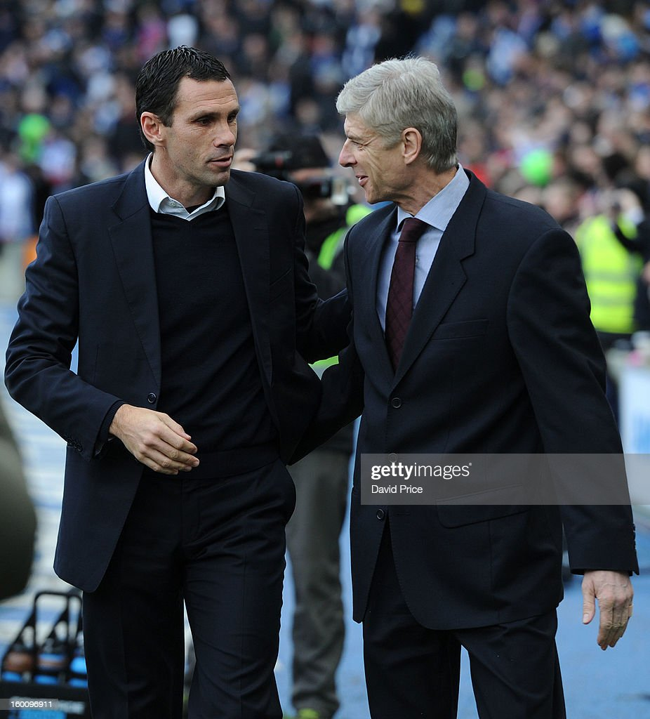 <a gi-track='captionPersonalityLinkClicked' href=/galleries/search?phrase=Arsene+Wenger&family=editorial&specificpeople=171184 ng-click='$event.stopPropagation()'>Arsene Wenger</a> the Manager of Arsenal with Gus Poyet the Manager of Brighton before the FA Cup Fourth Round match between Brighton & Hove Albion and Arsenal at the Amex Stadium on January 26, 2013 in Brighton, England.