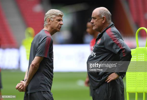 Arsene Wenger the Manager of Arsenal with his assistant Boro Primorac during an Arsenal Training Session at the Birds Nest on July 21 2017 in Beijing...