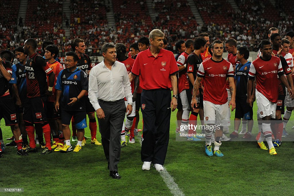 <a gi-track='captionPersonalityLinkClicked' href=/galleries/search?phrase=Arsene+Wenger&family=editorial&specificpeople=171184 ng-click='$event.stopPropagation()'>Arsene Wenger</a>,coach of Arsenal (R) and <a gi-track='captionPersonalityLinkClicked' href=/galleries/search?phrase=Dragan+Stojkovic&family=editorial&specificpeople=625216 ng-click='$event.stopPropagation()'>Dragan Stojkovic</a>,coach of Nagoya Grampus look on after the pre-season friendly match between Nagoya Grampus and Arsenal at Toyota Stadium on July 22, 2013 in Toyota, Aichi, Japan.