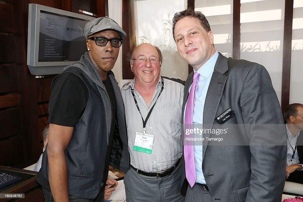 Arsenio Hall, Scott Blumenthal and Lee Villas are seen at the CBS Television Distribution cabana during NATPE at Fontainebleau Miami Beach on January 29, 2013 in Miami Beach, Florida.