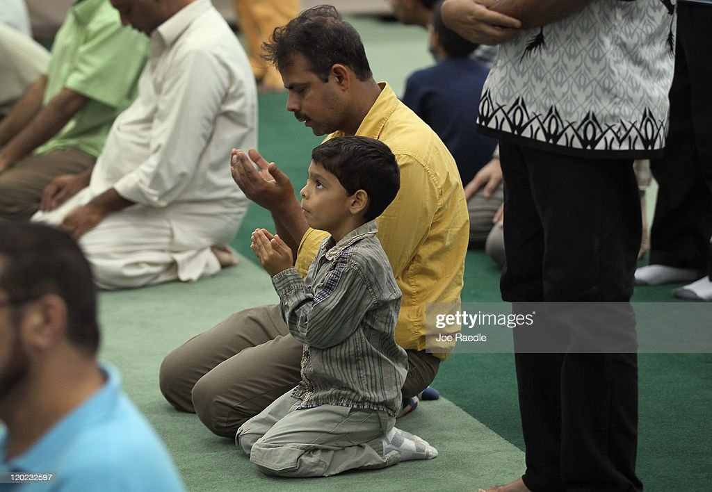 Arshad Khan and his son Saed Khan, 6, pray together on the evening of the first day of Ramadan at the Islamic Center of Greater Miami on August 1, 2011 in Miami, Florida. Worlwide Muslims honor Ramadan with the sighting of the new moon and is marked with fasting each morning at dawn and ends in the evening at dusk of each day for the next month, culminating in the three-day Eid ul-Fitr celebration