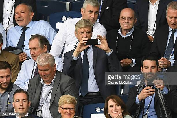 Arsne Wenger takes a picture of the Northern Ireland fans on his smartphone during the UEFA EURO 2016 Group C match between Northern Ireland and...