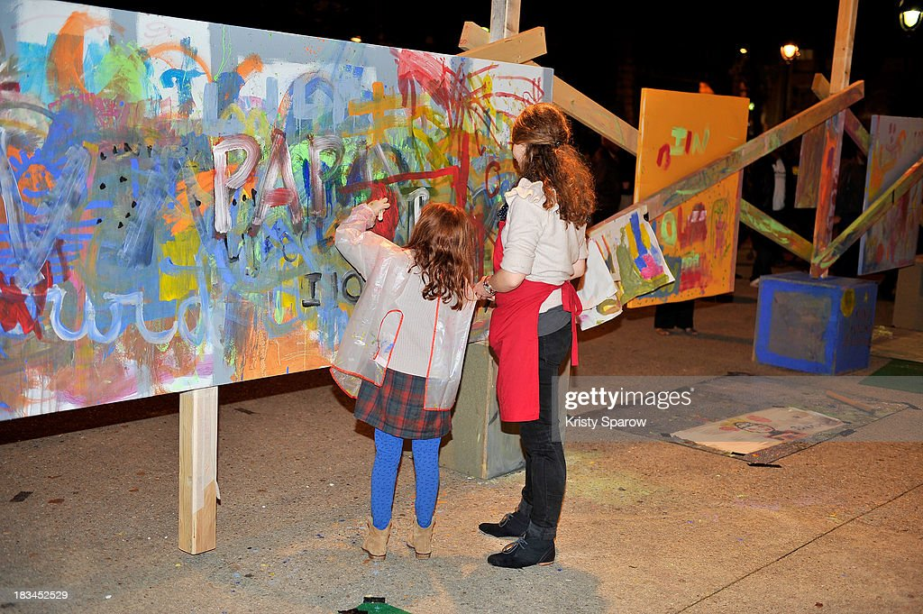 Art Activist Palle Nielsenconstructed a play area for children during Nuit Blanche to illustrate the work he continues to do worldwide in underprivileged neighborhoods at Place de la Bataille de Stalingrad on October 5, 2013 in Paris, France.