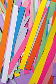 art background of colored paper stripes.