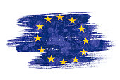 Art brush watercolor painting of EU flag blown in the wind isolated on white background.