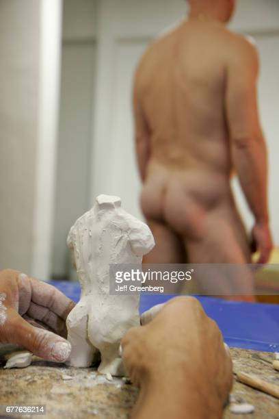 Art Center South Florida clay sculpture class with nude male model