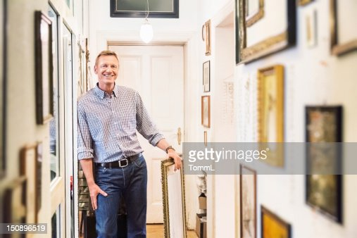 Art Collector in old Apartment Corridor
