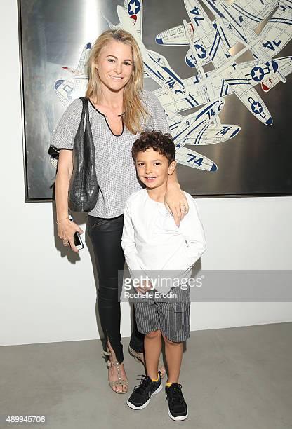 Art collectors Amy Eagle and son attend the Mike Sagato 'The Folly of Youth' exhibition at De Re Gallery on April 15 2015 in West Hollywood California