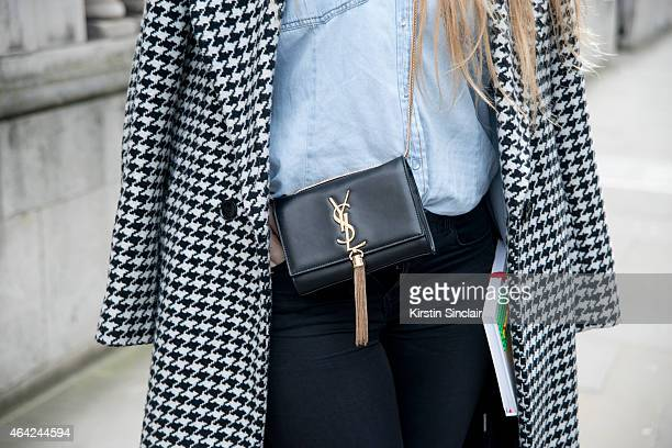 Art Critic Geraldine Pigault wears YSL bag Forever 21 jeans Primark jacket with a vintage shirt on day 3 of London Collections Women on February 22...