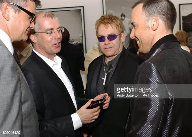 art dealer Jay Joplin musician Neil Tennant singer Sir Elton John and his partner David Furnish during the private view of photolondon the first...