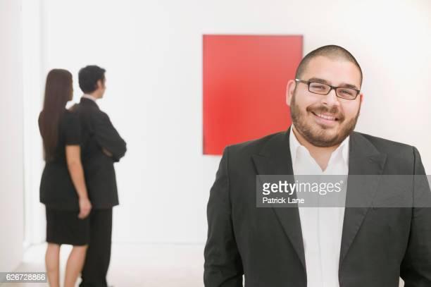 Art dealer with prospective clients