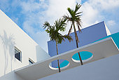 Art deco building with palm trees in Miami, Florida