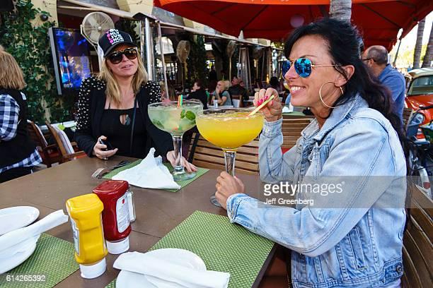 Art Deco Weekend women drinking alcoholic drinks