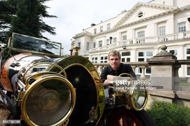 Art director and set decorator Gordon Grant from Glasgow Scotland with a replica of the car from Chitty Chitty Bang Bang outside Pinewood Studio's...
