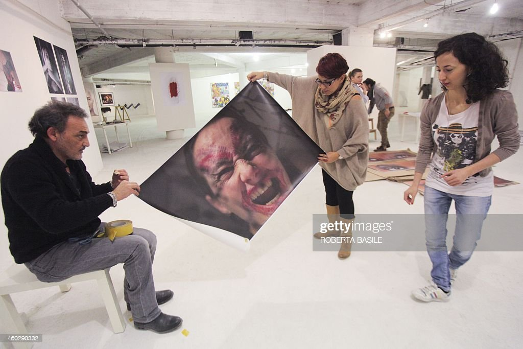 M art director Antonio Manfredi and his assistants take part to the preparation of the exhibition 'I am Woman' at CAM Casoria on December 10 2014 in...