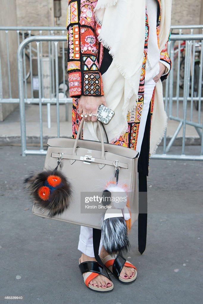 Art director at Kabuki Elini Halimi wears Barbara Bui coat Hermes bag Celine shoes and Fendi pom poms on day 3 of Paris Collections Women on March 05...