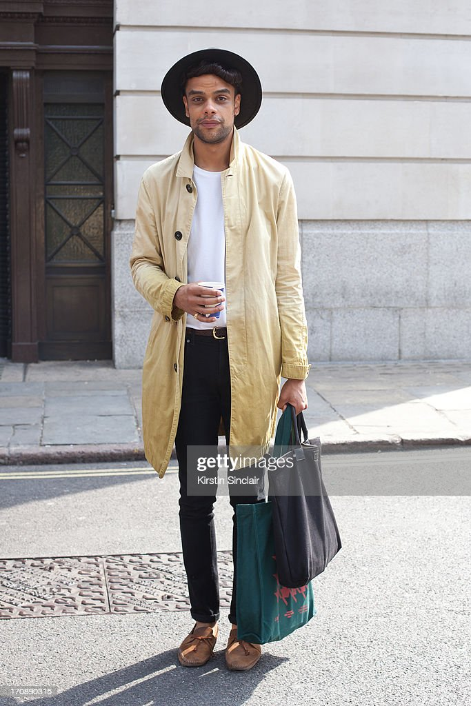 MTV Art Director Raven Smith wears Folk shoes, Dr Denim jeans, Cos t-shirt, Burberry Trench, M&S hat and Want Les Essentiels De La Vie bag on day 3 of London Collections: Men on June 18, 2013 in London, England.