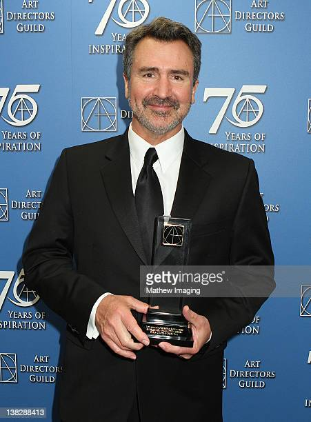 Art Director Tom Reta received the award for Excellence in a Production Design for a Feature Film Contemporary Film 'Girl with the Dragon Tattoo' at...