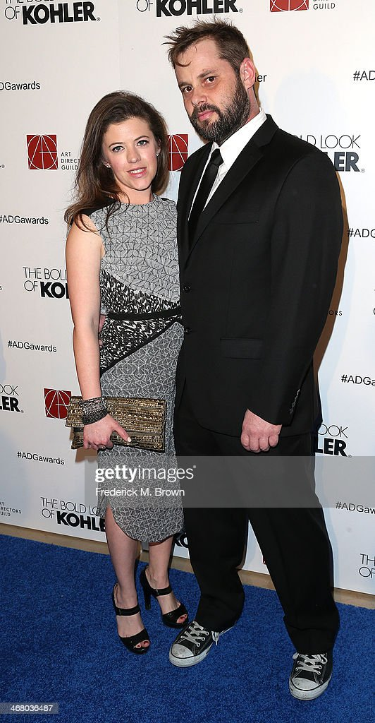 Art director Tyler B. Robinson (R) and his guest attend the 18th Annual Art Directors Guild Excellence in Production Design Awards at The Beverly Hilton Hotel on February 8, 2014 in Beverly Hills, California.