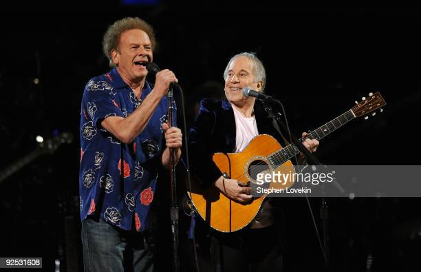 Art Garfunkel and Paul Simon perform onstage at the 25th Anniversary Rock Roll Hall of Fame Concert at Madison Square Garden on October 29 2009 in...