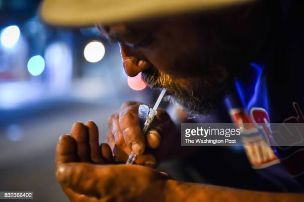 Art Gutierrez prepares a shot of heroin on Thursday July 20 in Philadelphia PA Gutierrez who grew up in California has been using heroin for two year...