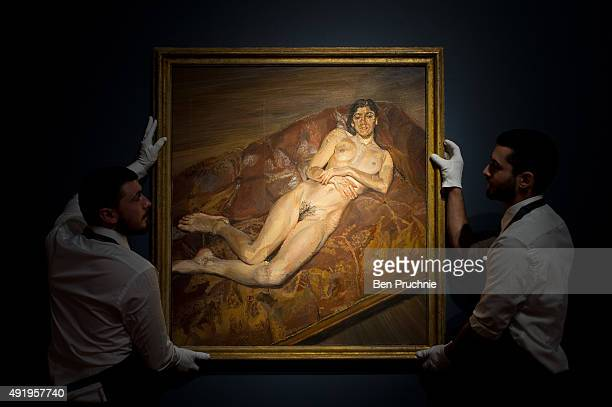 Art handlers hang the painting 'Naked Bella Freud' by artist Lucien Freud during the preview ahead of the artist's muse a curated evening sale in...