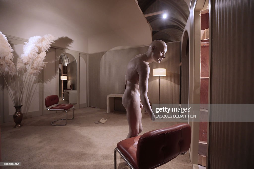 Art installation by Australian artist Kristian Burford entitled 'Last night you brought a man up to your room after having a late drink at the hotel bar; knowing that you are HIV positive you had sex which caused him to bleed; after a day of meetings you now return to your room' is displayed on October 22, 2013 at the Conciergerie museum in Paris, during an exhibition presenting French businessman François Pinault's contemporary art collection.