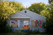 Art is placed on the front of the majority of the abandoned houses in the neighborhood of Brightmoor seen on October 15 2015 in Detroit Michigan