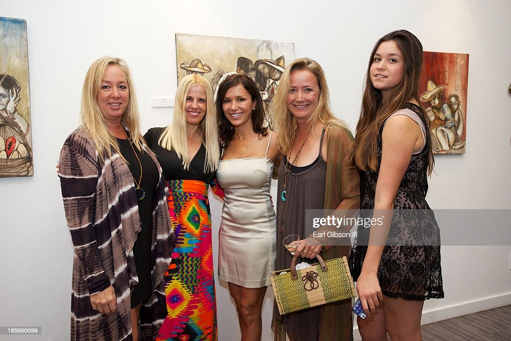 Art lovers pose for a photo at the 'Visions Of Mexico' An International Retrospective show for Chaz Guest at Quinn Studios on October 25, 2013 in Santa Monica, California.