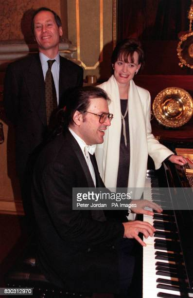 Art Minister Alan Howorth and Prime Minister's wife Cherie Blair listen as Russian pianist Andrei Gavrilov plays the piano at Goldsmiths' Hall London...