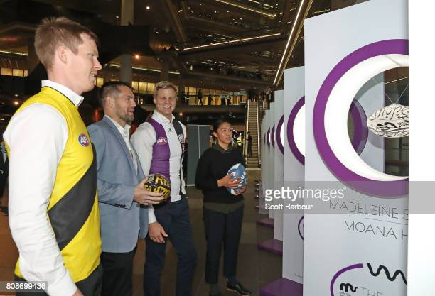 'Art of Football' supporters Luke Hodge and Darcy Vescio look at the exhibition with Nick Riewoldt and Jack Riewoldt during the 'Art of Football'...