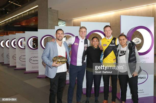 'Art of Football' supporters Luke Hodge Darcy Vescio and Moana Hope pose with Nick Riewoldt and Jack Riewoldt during the 'Art of Football' exhibition...