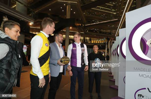 'Art of Football' supporters Moana Hope Luke Hodge and Darcy Vescio look at the exhibition with Nick Riewoldt and Jack Riewoldt during the 'Art of...