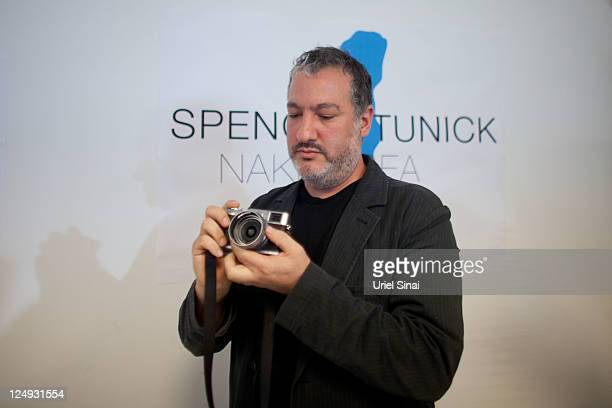 US art photographer Spencer Tunick uses a camera during a press conference on September 14 2011 in Tel Aviv Israel Tunick is in the region ahead of a...