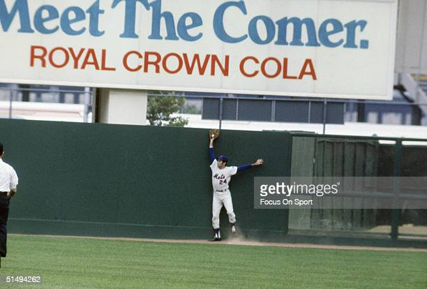 Art Shamsky of the New York Mets leaps up at the wall to take a hit away at Shea Stadium during the late 1960s in Flushing New York