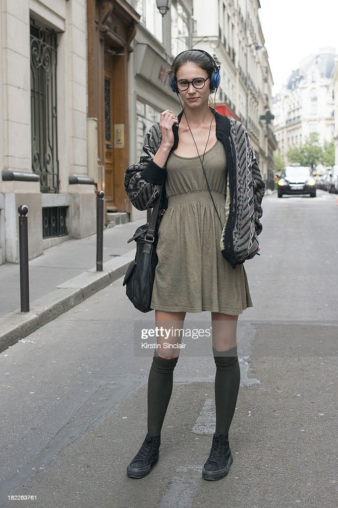 Art student and model Silvia Amancei wears an H and M dress, vintage cardigan and Oliver Peoples sunglasses on day 5 of Paris Fashion Week Spring/Summer 2014, Paris September 28, 2013 in Paris, France.