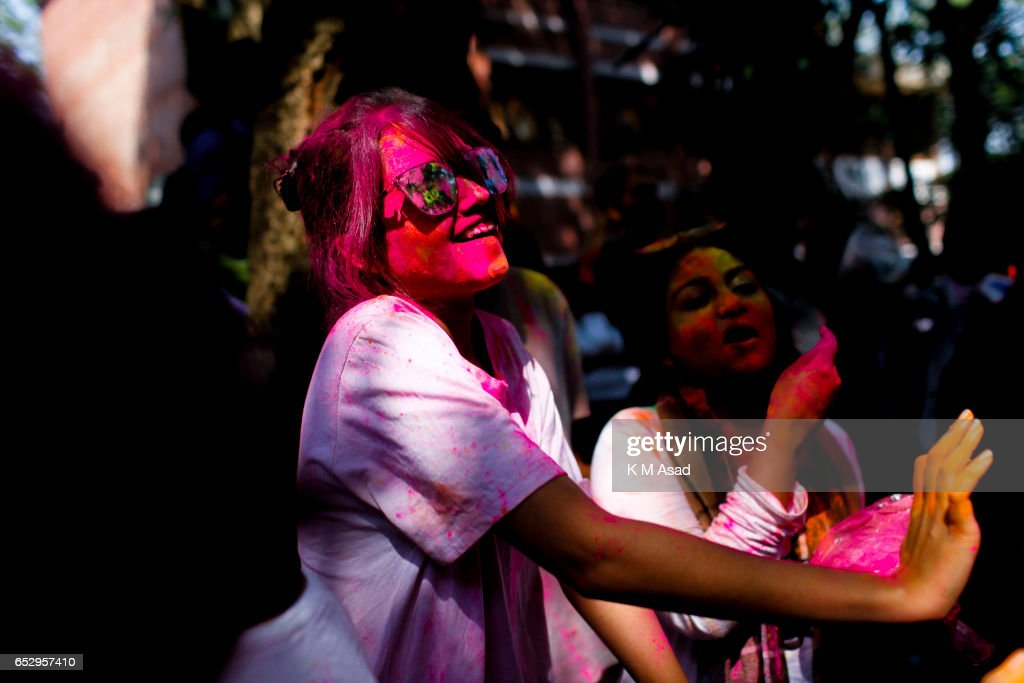 UNIVERCITY, DHAKA, BANGLADESH - : Art Students celebrate the Holi Festival or Festival of Colors after smearing each other with colored powder in Dhaka, Bangladesh. Holi festival is celebrated on the full moon day in the month of Phalguna and marks the start of the spring season.