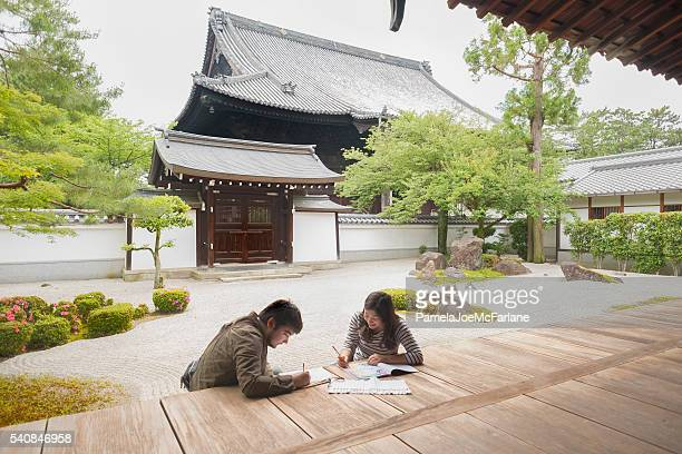 Art Students Drawing and Colouring in Japanese Meditation Rock Garden