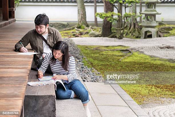 Art Students Drawing and Sketching in Traditional Japanese Zen Garden