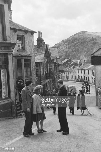 Art Students out for a stroll in Ambleside Cumbria 3rd July 1943 Original publication Picture Post 1475 Art School Carries On In Lakeland pub 1943