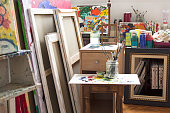 Art studio with paintings and painting materials.