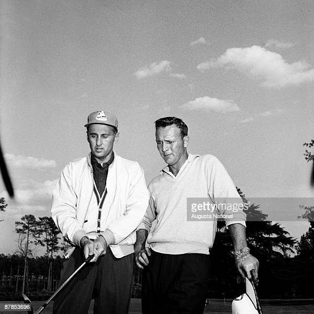 Art Wall Jr and Arnold Palmer during the 1960 Masters Tournament at Augusta National Golf Club in April 1960 in Augusta Georgia