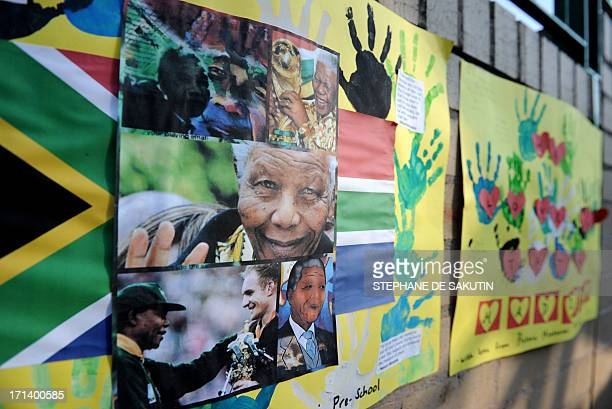 Art work by preschool children wishing former South African President Nelson Mandela well are displayed at the entrance of the MediClinic Heart...