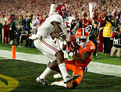 Artavis Scott of the Clemson Tigers attempts to catch an end zone pass broken up by Ronnie Harrison of the Alabama Crimson Tide in the third quarter...
