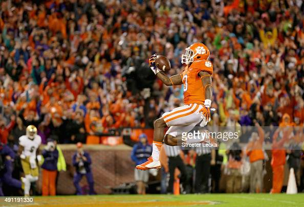 Artavis Scott of the Clemson Tigers reacts after scoring a touchdown against the Notre Dame Fighting Irish during their game at Clemson Memorial...